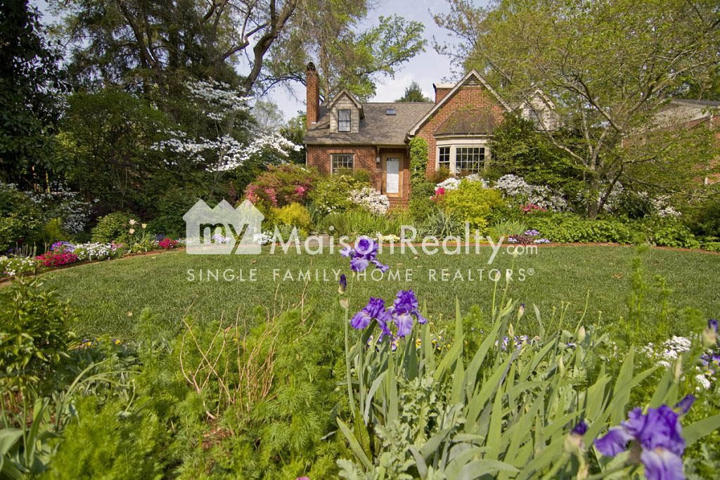 Beautifully landscaped Myers Park cottage-style home